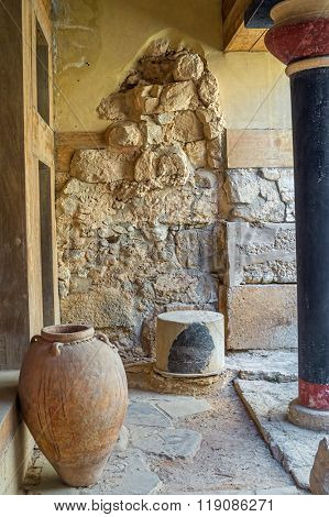 Knossos Palace colonnade interior with big ancient jar, Crete, Greece.