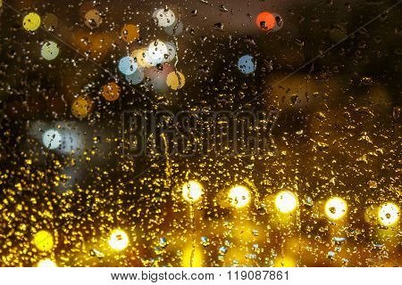 abstract background raindrops on  blurred lights background
