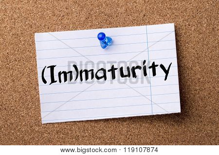 (im)maturity - Teared Note Paper Pinned On Bulletin Board