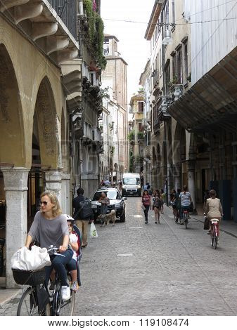 Treviso City Centre With People Riding A Bike