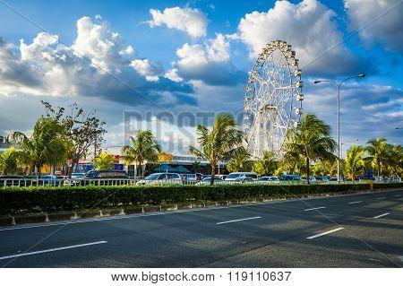 Ferris Wheel And Seaside Boulevard, In Pasay, Metro Manila, The Philippines.
