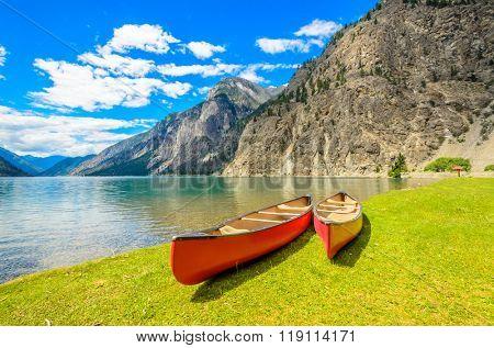 Majestic mountain lake in Canada. Seton Lake in British Columbia, Canada. Red canoe. poster