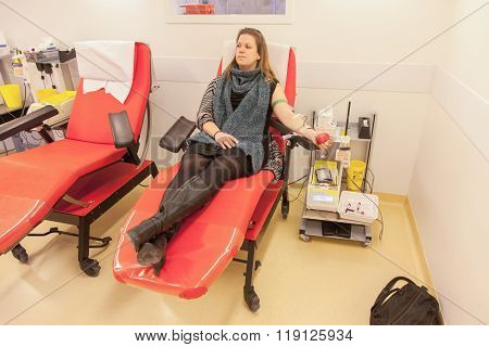 Donor In An Armchair Donates Blood