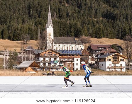 Two People Skating On The Ice