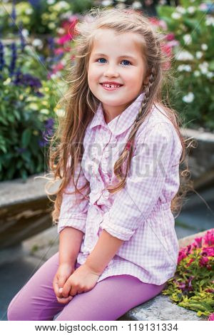 Little Girl With Tresses In Flowers