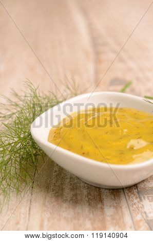 Dill sauce in a white bowl, food background with selective focus