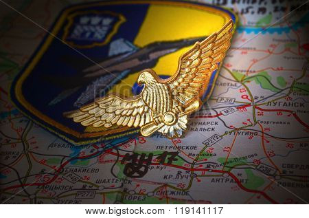 Cockade of Ukrainian Army. Eastern Ukraine map with site of MH-17 flight crash as background. on January 31,2016 in Kiev, Ukraine