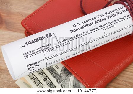Money In Wallet And Tax Form With Calculator On Wooden Table