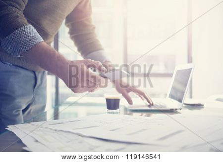 Businessman working generic design laptop and smartphone.  Working hard new architectural project. B