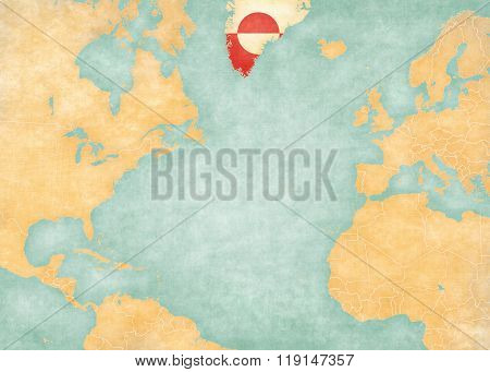 Greenland (Greenlandic flag) on the map of North Atlantic Ocean. The Map is in vintage summer style and sunny mood. The map has soft grunge and vintage atmosphere like watercolor painting on old paper.