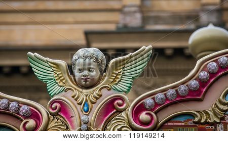 Cherub on a merry go round