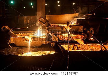 Pouring liquid titanium slag from arc furnace