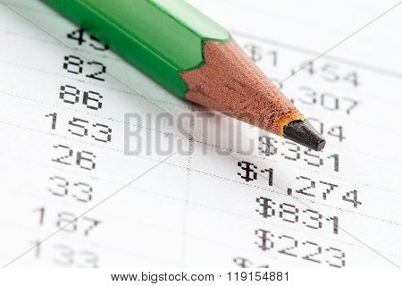 Green Pencil And Financial Chart