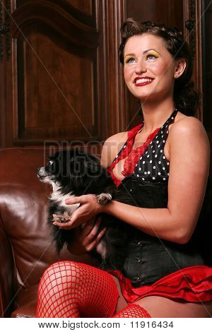 Beautiful pinup girl with puppy poster