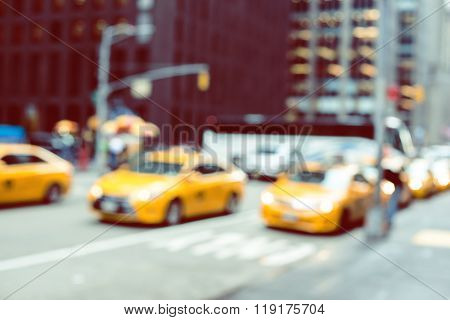 Blurred picture of yellow taxis on Manhattan streets