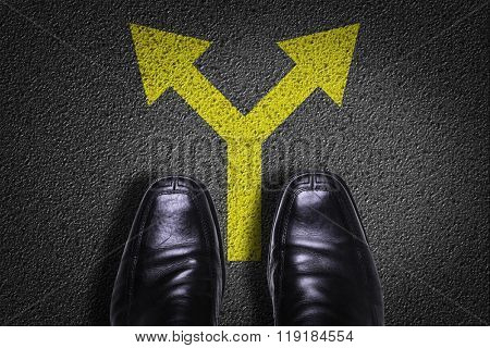 Top View of Business Shoes on the floor with directional arrow