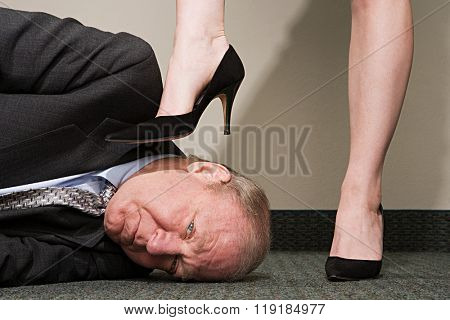 Woman dominating businessman