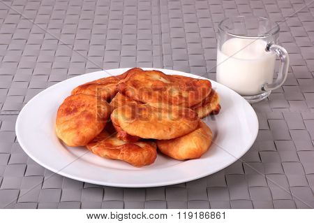Fried Cakes On White Plate And Cup Of Milk