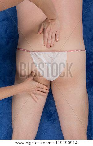 Male Adult Receiving A Massage. Studio Shot.