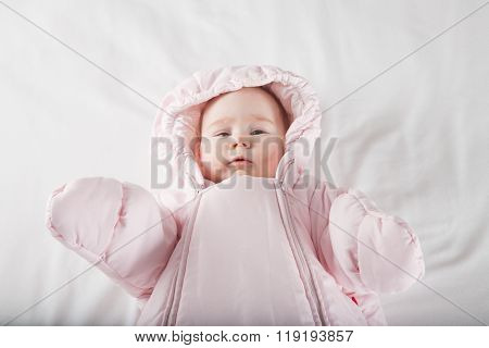 Baby Face Wrapped In Pink Snowsuit