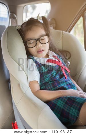 Little Girl Sleeping In The Carseat
