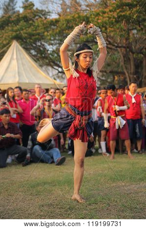 AYUTTHAYA,THAILAND - MARCH 17,2013 : Female adult asian muay thai fighter shows traditional Wai Kroo ceremonal dance.