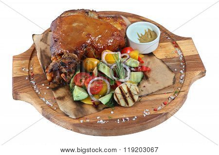 Pork Knuckle With Vegetable Salad On Round Wooden Board, Isolated.