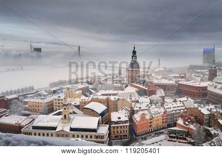 Winter aerial view of Riga historical centre in fog. Landmarks of Latvia. poster