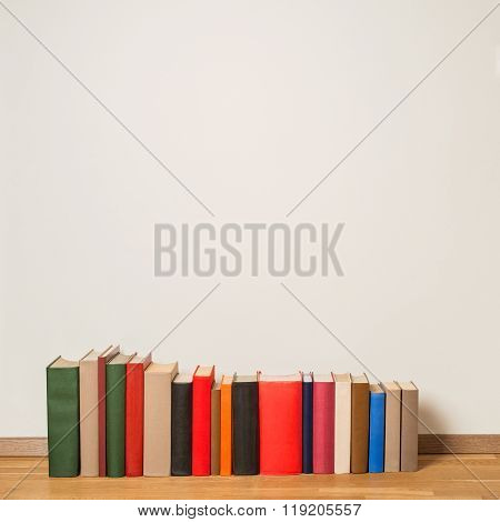 Old books on wooden floor