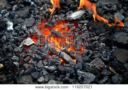 Embers close-up. Burning coals in a barbecue grill.
