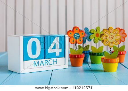 March 4th. Image of march 4 wooden color calendar with flower on white background.  First spring day