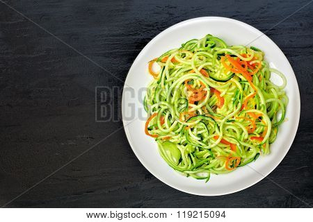 Low carb zucchini noodle dish on dark slate