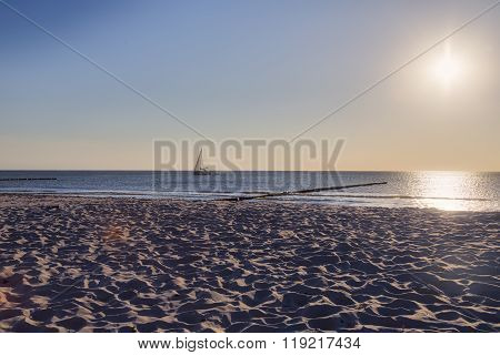 Ocean Landscape With Sailing Boat And Sun
