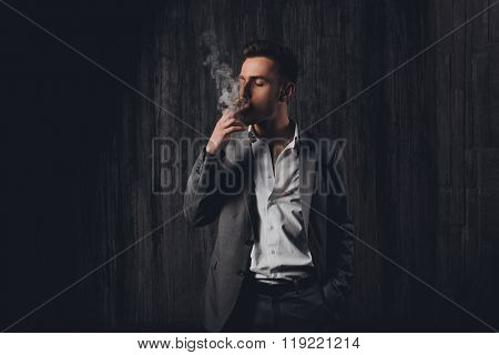 Sexy Brutal Man In Gray Suit Smoking A Cigar