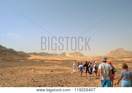 A Group Of Tourists On The Way To The Colored Canyon
