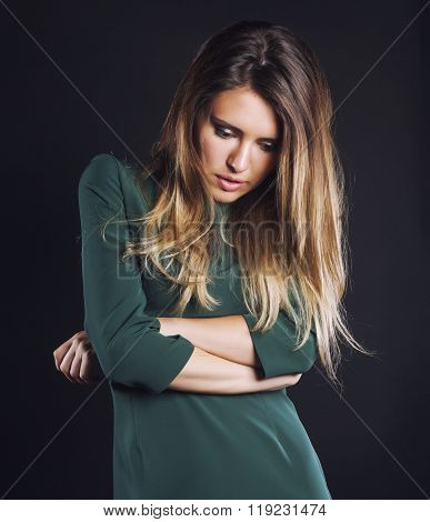 young blond real woman emotional in depression dark indoor