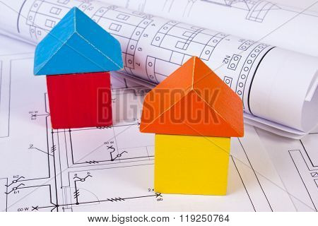 Houses Of Wooden Blocks And Rolls Of Diagrams On Construction Drawing Of House