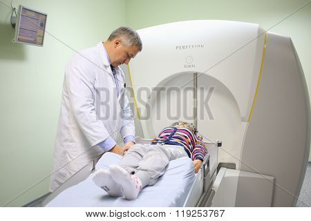 MOSCOW - MAY 19, 2015: The attending physician prepares patient for the procedure on the Gamma Knife in the department of radiology and radiosurgery at the Burdenko Institute of Neurosurgery in Moscow
