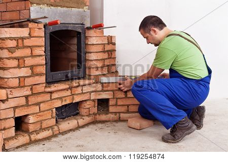 Construction Worker Building A Masonry Heater