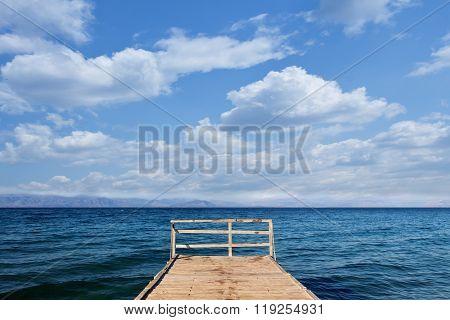 Wooden Pier In The Mediterranean Sea Area - Copy Space