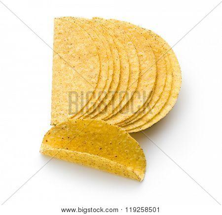 crispy taco shells on white background