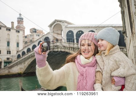 Mother And Daughter Taking Photos In Front Of Ponte Di Rialto