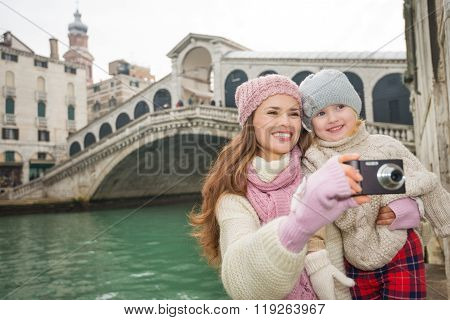 Smiling Mother And Daughter Taking Photos Near Ponte Di Rialto