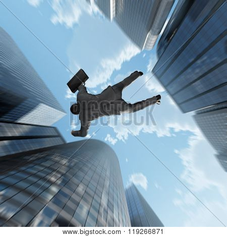businessman falling into the abyss