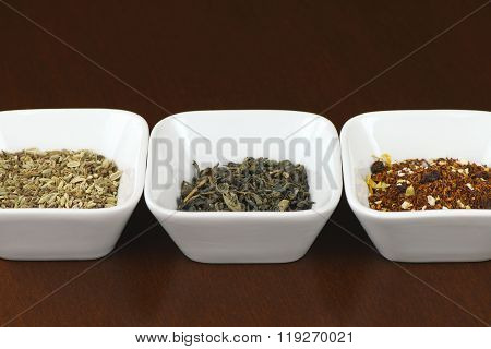 Tea leaves in square bowls