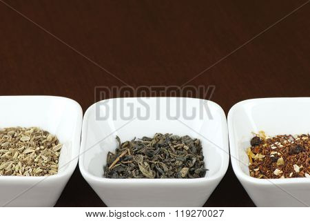 Tea leaves in square bowls, space for text