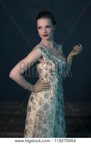 Retro 1950S Posh Fashion Woman In Gold Dress.