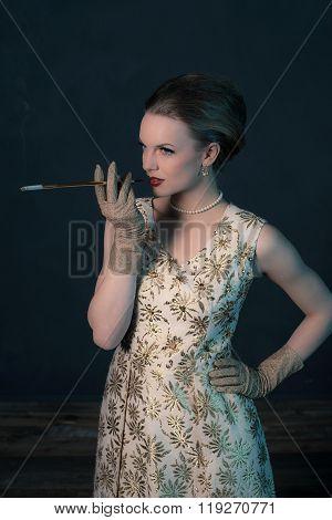 Sensual Retro 1950S Posh Fashion Woman In Gold Dress Holding Cigarette Pipe.