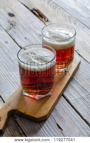 Two glasses of dark amber beer