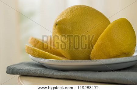 Lemons On Wooden Table Isolated